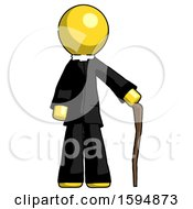 Yellow Clergy Man Standing With Hiking Stick