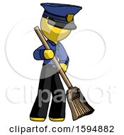 Yellow Police Man Sweeping Area With Broom
