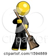 Yellow Clergy Man Sweeping Area With Broom