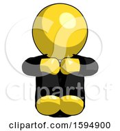 Yellow Clergy Man Sitting With Head Down Facing Forward