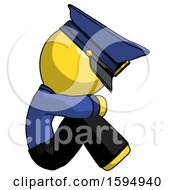 Yellow Police Man Sitting With Head Down Facing Sideways Right