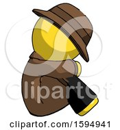 Yellow Detective Man Sitting With Head Down Facing Sideways Right