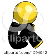 Yellow Clergy Man Sitting With Head Down Facing Sideways Right