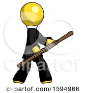 Yellow Clergy Man Holding Bo Staff In Sideways Defense Pose