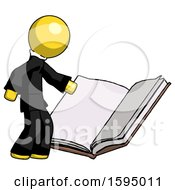 Yellow Clergy Man Reading Big Book While Standing Beside It