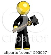 Yellow Clergy Man With Sledgehammer Standing Ready To Work Or Defend
