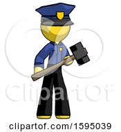 Yellow Police Man With Sledgehammer Standing Ready To Work Or Defend