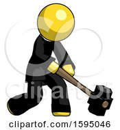Yellow Clergy Man Hitting With Sledgehammer Or Smashing Something At Angle