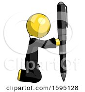 Yellow Clergy Man Posing With Giant Pen In Powerful Yet Awkward Manner