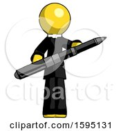 Yellow Clergy Man Posing Confidently With Giant Pen