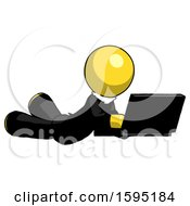 Yellow Clergy Man Using Laptop Computer While Lying On Floor Side Angled View