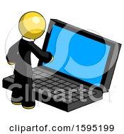 Yellow Clergy Man Using Large Laptop Computer