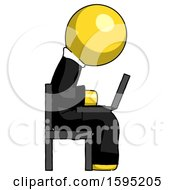 Yellow Clergy Man Using Laptop Computer While Sitting In Chair View From Side