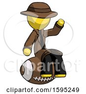 Yellow Detective Man Sitting On Giant Football