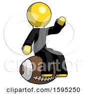 Yellow Clergy Man Sitting On Giant Football