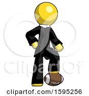 Yellow Clergy Man Standing With Foot On Football
