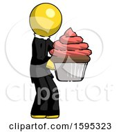 Yellow Clergy Man Holding Large Cupcake Ready To Eat Or Serve