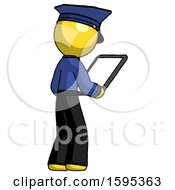 Yellow Police Man Looking At Tablet Device Computer Facing Away