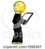 Yellow Clergy Man Looking At Tablet Device Computer Facing Away