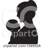 Clipart Of A Black Silhouetted Mother Holding A Baby Royalty Free Vector Illustration