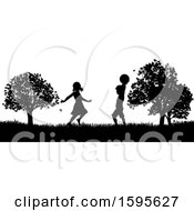 Silhouetted Children Playing In A Park
