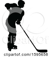 Clipart Of A Silhouetted Male Ice Hockey Player Royalty Free Vector Illustration