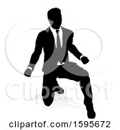 Silhouetted Business Man With A Shadow On A White Background