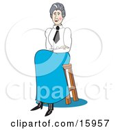 Proper Female School Teacher In A White Shirt Black Tie And Blue Sirt Seated On A Stool
