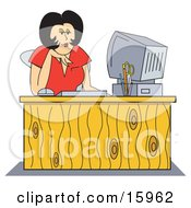 Black Haired Female Receptionist In A Red Shirt Working At Her Computer Desk