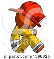 Orange Firefighter Fireman Man Sitting With Head Down Facing Sideways Right