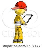 Yellow Firefighter Fireman Man Looking At Tablet Device Computer Facing Away