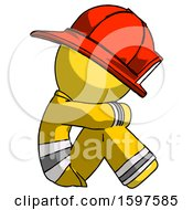 Yellow Firefighter Fireman Man Sitting With Head Down Facing Sideways Right