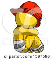 Yellow Firefighter Fireman Man Sitting With Head Down Back View Facing Right