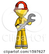 Yellow Firefighter Fireman Man Holding Large Wrench With Both Hands