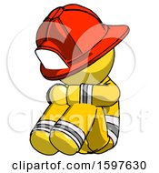Yellow Firefighter Fireman Man Sitting With Head Down Facing Angle Left