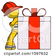 Yellow Firefighter Fireman Man Gift Concept Leaning Against Large Present