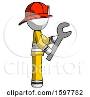 White Firefighter Fireman Man Using Wrench Adjusting Something To Right