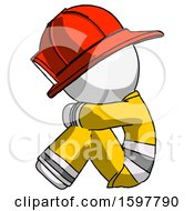 White Firefighter Fireman Man Sitting With Head Down Facing Sideways Left