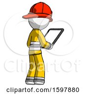 White Firefighter Fireman Man Looking At Tablet Device Computer Facing Away