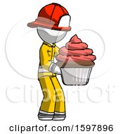 White Firefighter Fireman Man Holding Large Cupcake Ready To Eat Or Serve