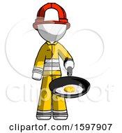 White Firefighter Fireman Man Frying Egg In Pan Or Wok