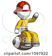 White Firefighter Fireman Man Sitting On Giant Football
