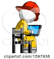 White Firefighter Fireman Man Using Laptop Computer While Sitting In Chair View From Back