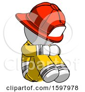 White Firefighter Fireman Man Sitting With Head Down Facing Angle Right