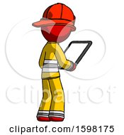 Red Firefighter Fireman Man Looking At Tablet Device Computer Facing Away
