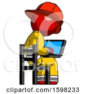 Red Firefighter Fireman Man Using Laptop Computer While Sitting In Chair View From Back