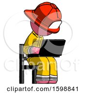 Pink Firefighter Fireman Man Using Laptop Computer While Sitting In Chair Angled Right