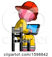 Pink Firefighter Fireman Man Using Laptop Computer While Sitting In Chair View From Back