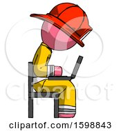 Pink Firefighter Fireman Man Using Laptop Computer While Sitting In Chair View From Side
