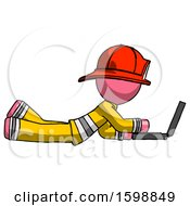 Pink Firefighter Fireman Man Using Laptop Computer While Lying On Floor Side View